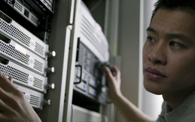 Computer Technician --- Image by © Royalty-Free/Corbis